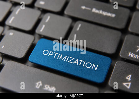 Business optimization service keyboard button for online marketing concept. SEO text key closeup in blue color. - Stock Photo