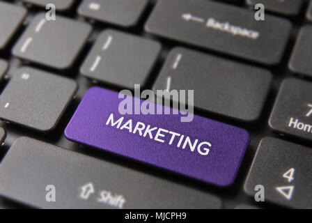 Marketing computer button concept, closeup of keyboard with blue business laptop key. - Stock Photo
