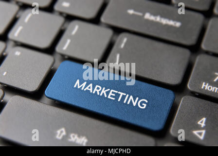 Digital marketing service concept, blue computer button with text for online internet business. - Stock Photo