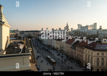 Sunset over Warsaw old town and the financial district tower in the background with the Palace of culture and science in Poland capital city - Stock Photo