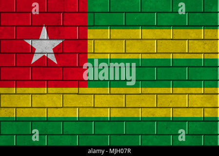 Togo flag painted on a brick wall - Stock Photo