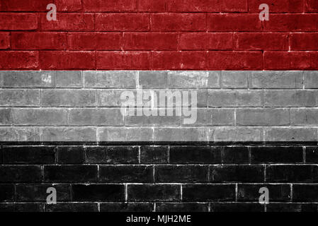 Yemen flag painted on a brick wall - Stock Photo