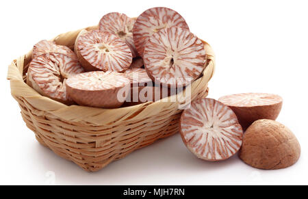Betel nuts in a basket over white background - Stock Photo