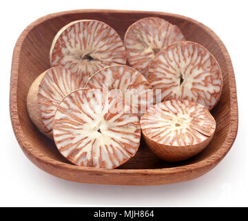 Betel nuts in a bowl over white background - Stock Photo