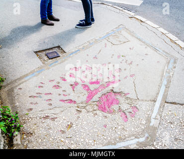 Markings on the streets of Sarajevo indicating where mortar shells exploded during Bosnian war in 1990s - Stock Photo