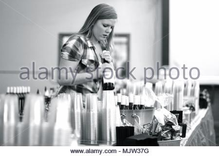Yakima, Washington / USA - January 22, 2017:  Bartenders converse and serve drinks with people at a charity auction event. - Stock Photo