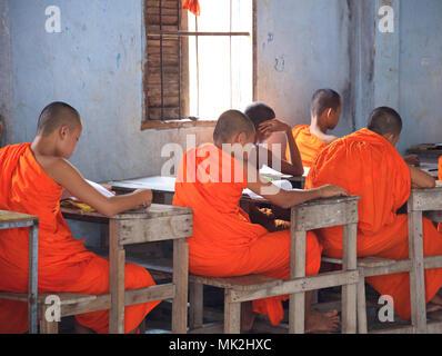 Novice Buddhist monk school children in a classroom in rural Cambodia - Stock Photo