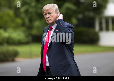 Washington, DC. 5th May, 2018. United States President Donald Trump crosses the South Lawn after arriving at the White House on May 5, 2018 in Washington, DC. President Trump traveled to Cleveland, Ohio to speak at Public Hall ahead of state primary elections. Credit: Zach Gibson/Pool via CNP | usage worldwide Credit: dpa/Alamy Live News - Stock Photo