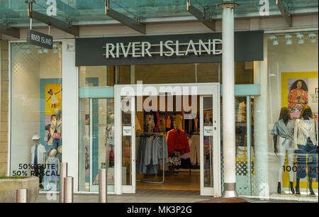 Large sign above the entrance to a River Island store on a retail park - Stock Photo