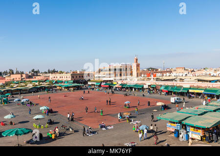 MARRAKESH, MOROCCO - DECEMBER 17, 2017: Jamaa el Fna market square is a famous square and market place in Marrakesh's medina quarter. - Stock Photo