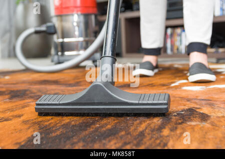 Great concept of home cleaning, vacuuming the floor, carpet. - Stock Photo