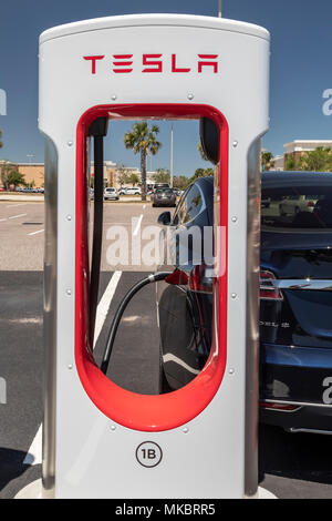 West Melbourne, Florida - A Tesla Model S charging at an electric car Supercharger station. - Stock Photo