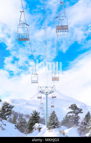 Snowy landscape and chairlifts, ski resorts and winter sports in mountain areas, Station Pierre Saint Martin, municipality of Arette (64), Pyrenees, France - Stock Photo
