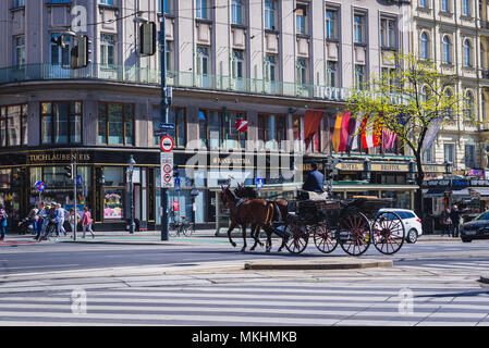 Horse-drawn carriage called Fiaker in front of Bristol Hotel in Vienna, Austria - Stock Photo