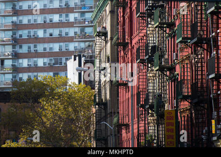 NEW YORK - USA- 28 OCTOBER 2018. Close-up view of New York City style apartment buildings with emergency stairs along Mott Street in Chinatown - Stock Photo