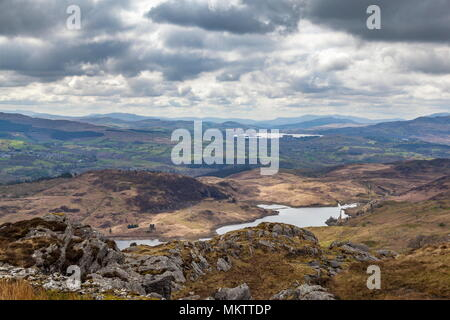 The twin disused  reactor buildings of Trawsfynydd can be seen in the distance next to the lake of Llyn Trawsfynydd while Tanygrisiau reservoir, part  - Stock Photo