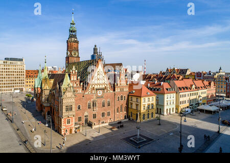 Wroclaw, Poland. Historic marker place (Rynek) and Old Gothic city hall, built in 14th century. Aerial view. Early morning - Stock Photo