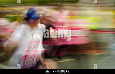 A woman competes in the Race for Life, a race staged round the UK to raise money for Cancer Research. - Stock Photo