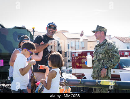 SAN FRANCISCO (Oct. 6, 2017) Utilitiesman 2nd Class William Sturgeon, attached to Amphibious Construction Battalion 1 and from Cleveland, Ohio, talks to guests about the lightweight portable water purification system, during Fleet Week San Francisco 2017. Fleet week provides an opportunity for the American public to meet their Navy, Marine Corps, and Coast Guard team and to experience America's sea service. Fleet Week San Francisco will highlight naval personnel, equipment, technology, and capabilities, with an emphasis on humanitarian assistance and disaster response.  (U.S. Navy Photo by Mas - Stock Photo