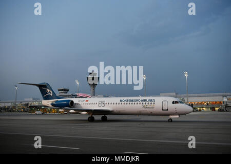 Montenegro, Airlines, Fokker, F100, 100, Twilight, Roll Out, Airfield, Tower, Terminal 1, Aircraft, Airplane, Plane, Airport Munich, MUC, Germany, - Stock Photo