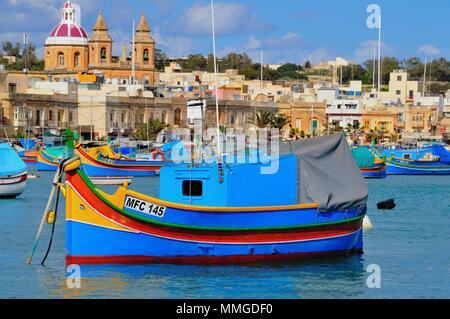 Moored Fishing Craft Marsaxlokk Harbour Malta - Stock Photo