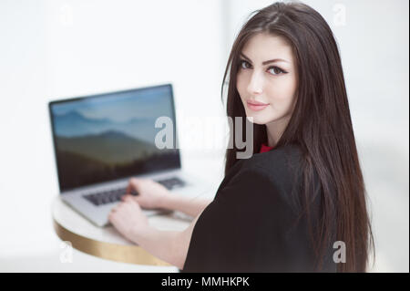 Young friendly operator woman agent typing on laptop - Stock Photo