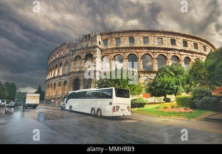 Cityscape with ancient Roman Amphitheater (Pula Arena) in Pula. Croatia - Stock Photo