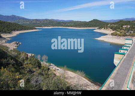 The reservoir and dam of Darnius Boadella in the Province of Girona, Alt Emporda, Catalonia, Spain - Stock Photo