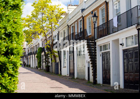 LONDON, UK - MAY 10th, 2018: Holland Park Mews is a cobbled through road approached through its own arch off Holland Park in the Royal Borough of Kens - Stock Photo