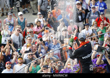 Indianapolis, Indiana, USA. 12th May, 2018. WILL POWER (12) of Australia celebrates on the podium after winning the IndyCar Grand Prix at Indianapolis Motor Speedway Road Course in Indianapolis, Indiana. Credit: Chris Owens Asp Inc/ASP/ZUMA Wire/Alamy Live News - Stock Photo