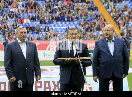 Rostov On Don, Russia. 13th May, 2018. ROSTOV-ON-DON, RUSSIA - MAY 13, 2018: Rostov-on-Don Region Governor Vasily Golubev (C) speaks at a ceremony to open Rostov Arena Stadium ahead of a 2017/2018 Russian Football Premier League Round 30 match between FC Rostov and FC Ural, the third trial for the venue to host ahead of the 2018 FIFA World Cup. Valery Matytsin/TASS Credit: ITAR-TASS News Agency/Alamy Live News - Stock Photo