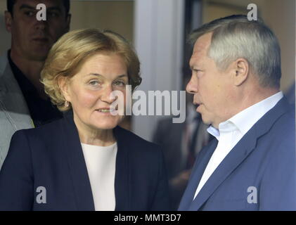 Rostov On Don, Russia. 13th May, 2018. ROSTOV-ON-DON, RUSSIA - MAY 13, 2018: Russia's acting Deputy Prime Minister Olga Golodets (L) and Rostov-on-Don Region Governor Vasily Golubev attend a ceremony to open Rostov Arena Stadium ahead of a 2017/2018 Russian Football Premier League Round 30 match between FC Rostov and FC Ural, the third trial for the venue to host ahead of the 2018 FIFA World Cup. Valery Matytsin/TASS Credit: ITAR-TASS News Agency/Alamy Live News - Stock Photo
