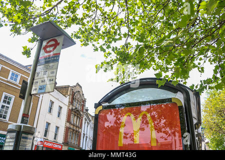 London UK. 13th May 2018. A McDonalds cheap meal advertised on a bus stop in Wimbledon. London Mayor Sadiq Khan has drawn up  plans to ban junk food advertsing on TFL London Underground and Buses  in order to reduce the growing problem  of childhood obesity Credit: amer ghazzal/Alamy Live News - Stock Photo