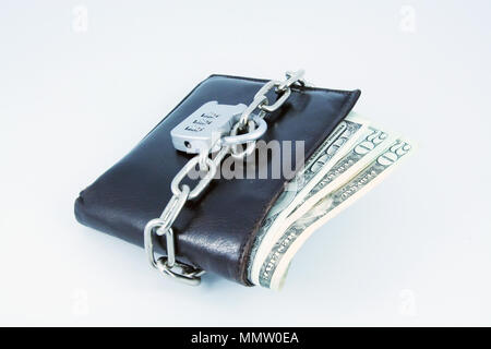 Brown leather wallet with chain. Locked brown leather wallet. Financial crisis. Blocked financing. - Stock Photo