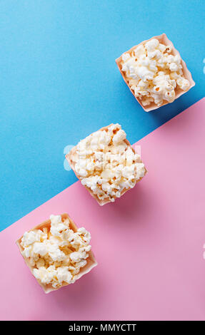 Popcorn  on blue and pink background - Stock Photo