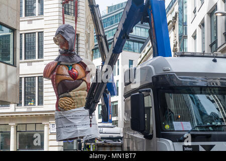 London, UK. 13th May, 2018. Damien Hirst's 'Temple' (2008) is being removed using a crane. The bronze sculpture was displayed in the City of London as part of Sculpture in the City until May 13, 2018 Credit: michelmond/Alamy Live News - Stock Photo