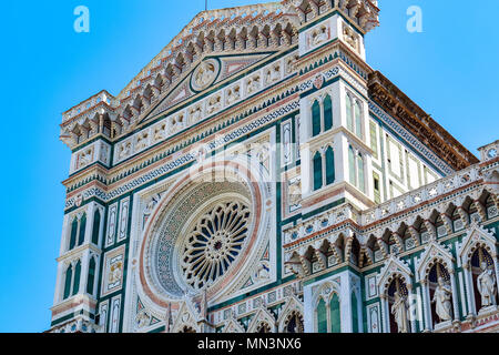 Facade of the Cattedrale di Santa Maria del Fiore (Cathedral of Saint Mary of the Flower) in Florence, Italy against a cloudless sky - Stock Photo