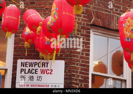 Chinese lanterns hanging in China Town, London, above the street - Stock Photo
