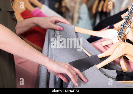 Shopping. Woman is choosing what to buy - Stock Photo