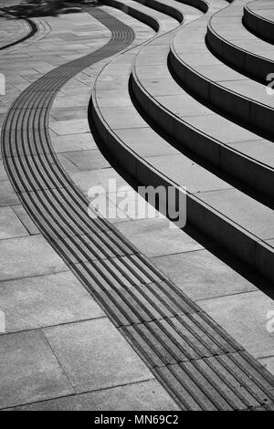 Curving architectural steps in pavement leading through image - Stock Photo