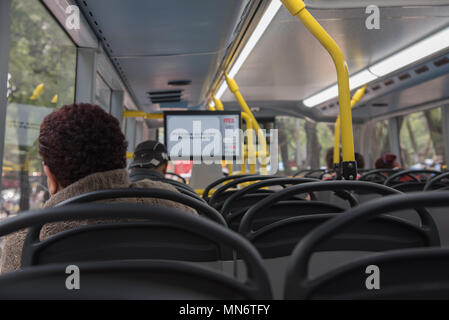 Woman on a Metrobús double-decker bus in Mexico City - Stock Photo