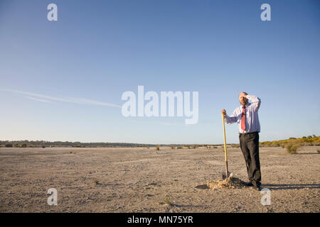 A business man digging a hole, business concepts. - Stock Photo