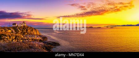 Sunset over the lighthouse in Henningsvaer on Lofoten islands - Stock Photo