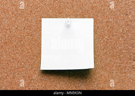 empty square white pinned sheet on a brown cork reminder - Stock Photo