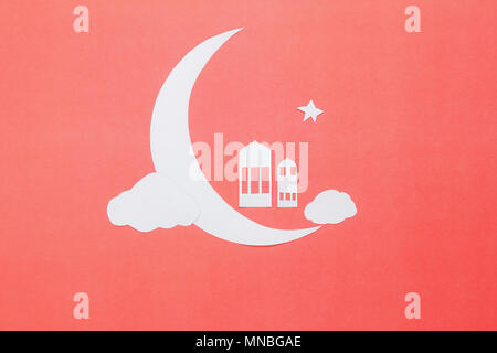 Table top view aerial image of decorations Ramadan Kareem holiday background.Flat lay objects accessories DIY paper cut moon shape with star and Islam - Stock Photo