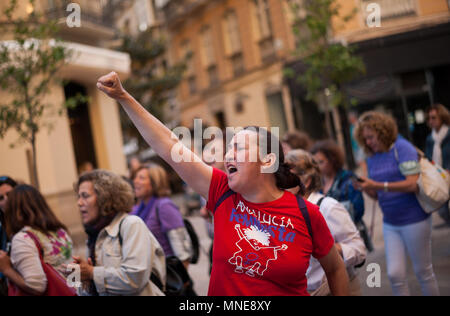 Malaga, Malaga, Spain. 16th May, 2018. A woman rises her fist as she takes part in a demonstration against violence against womens during a protest to claim to the Spanish Government to better funding of the state budget agreed in the pact against gender violence. The main slogan in the demonstration is: ''agreement = budget' Credit: Jesus Merida/SOPA Images/ZUMA Wire/Alamy Live News - Stock Photo