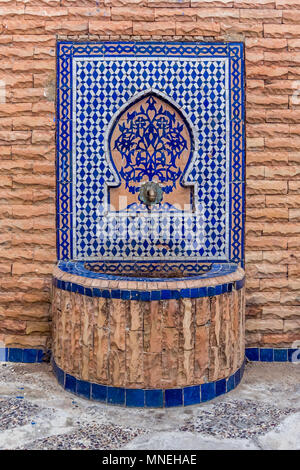 Beautiful water fountain decorated with moroccan tiles - Stock Photo