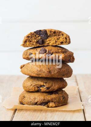 Whole grain vegan spelt pumpkin cookies with chocolate chips - Stock Photo
