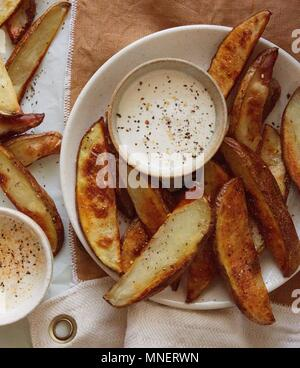 Potato Fries with Dips and Seasonings - Stock Photo