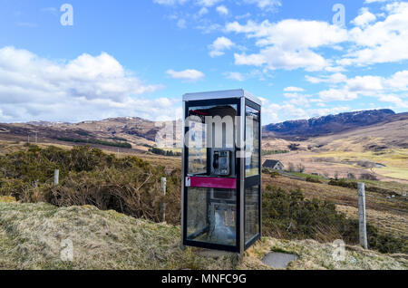 Abandoned British Telecom phone booth in rural Scotland - Stock Photo